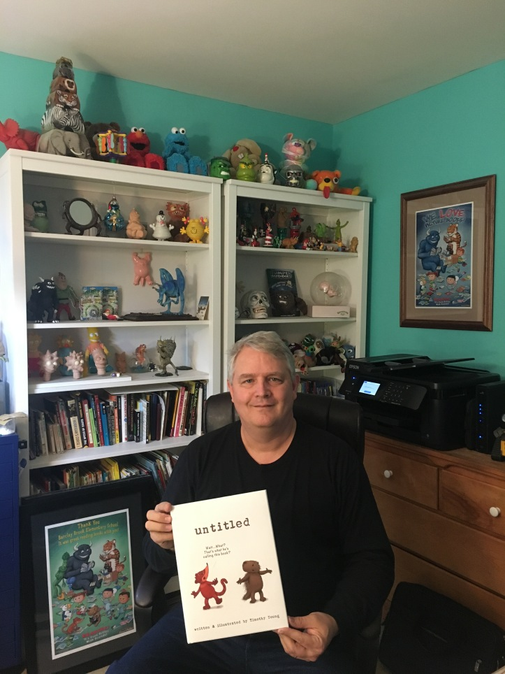 "Timothy Young holding his first copy of ""untitled"""