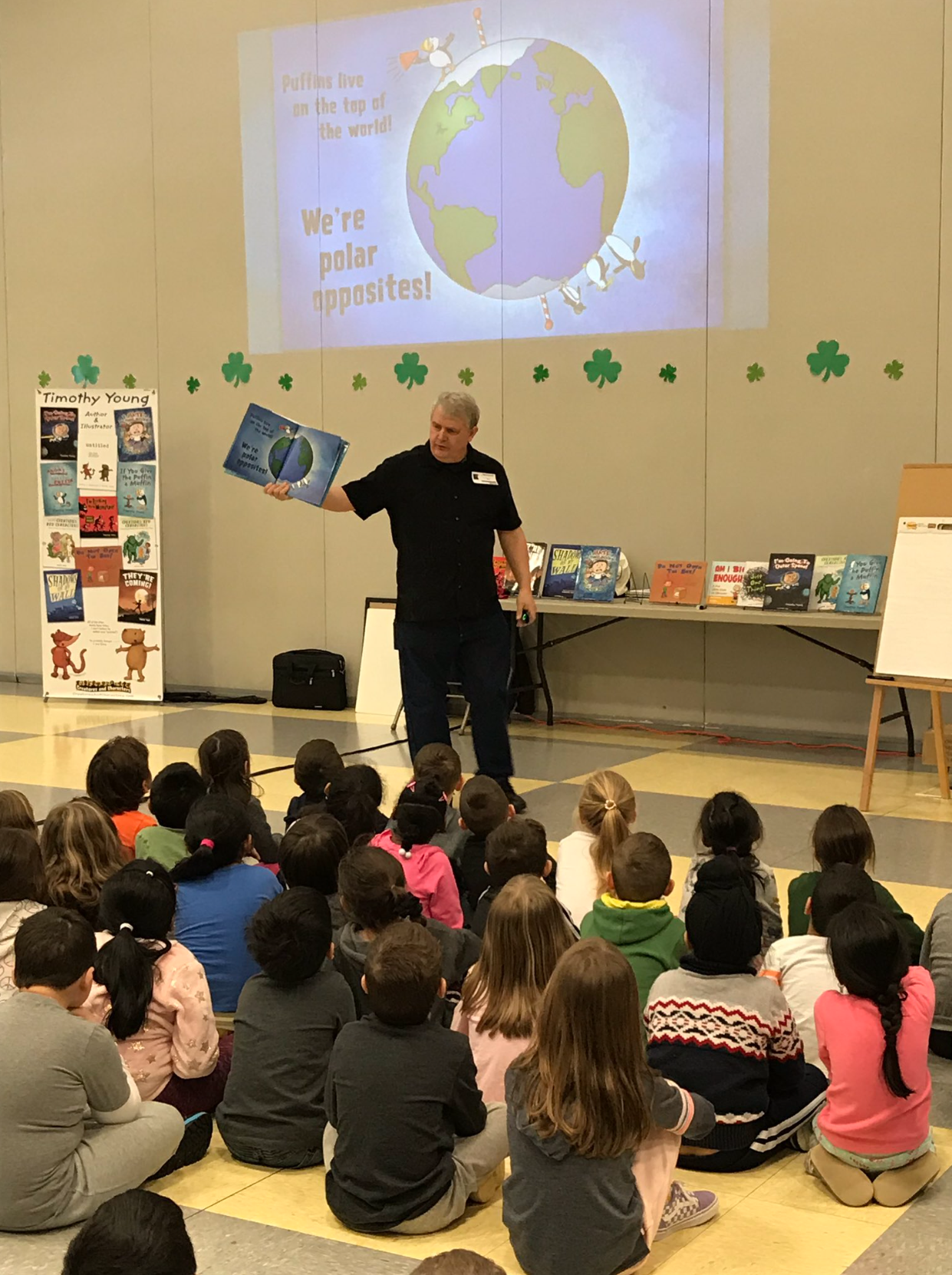Author/illustrator Timothy Young reads his book The Angry Little Puffin at an author visit assembly.