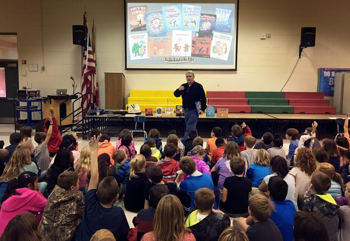 Author/illustrator Timothy Young presents to a group of elementary school students.